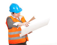 Fat female architect or engineer reading blueprint Royalty Free Stock Photography