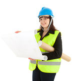 Fat female architect reading blueprints Royalty Free Stock Photo