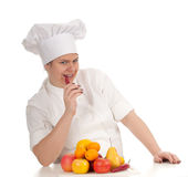 Fat female cook with fruits Stock Image