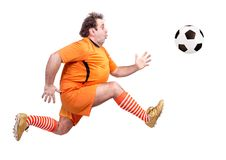 Fat football player kicking the ball Stock Photo