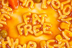 Fat Free. Alphabet shaped pasta forming the words FAT FREE in tomato sauce Royalty Free Stock Photography