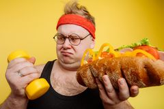 Fat man choise between sport and fastfood. Fat funny Man is carried away by temptation Royalty Free Stock Photography