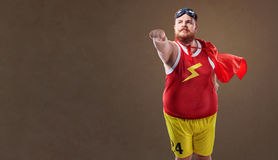 Fat funny man in a superhero costume Royalty Free Stock Photo