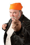 Fat gang member. With closed fists and orange bandanna on white background royalty free stock image