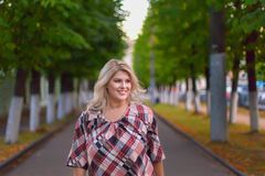 Fat girl with a beautiful smile. Th fat girl with a beautiful smile royalty free stock photos