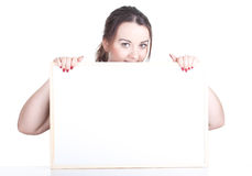 Fat girl  with blank sign, billboard Royalty Free Stock Photos