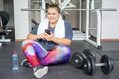 Fat girl in a gym stock photography