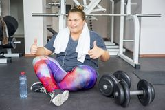 Fat girl in a gym stock photo