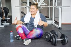 Fat girl in a gym royalty free stock photo