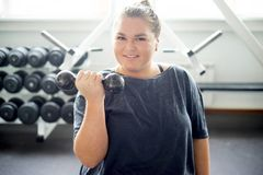 Fat girl in a gym stock photos