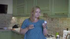 Fat girl in the kitchen stock video