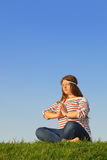 Fat girl meditates and thinks at green grass Stock Images