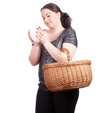 Fat girl with ostriches egg and wicker basket Stock Photos