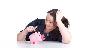 Fat girl with pink piggy bank Royalty Free Stock Image