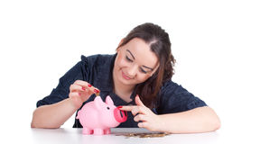 Fat girl with pink piggy bank Royalty Free Stock Images