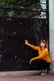 Fat girl standing at the iron gate. The fat girl standing at the iron gate stock images