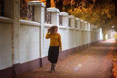 Fat girl walking in the autumn Park stock image