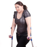 Fat girl walking on crutches Royalty Free Stock Photography