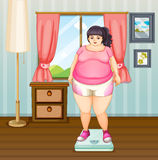 A fat girl on a weighing scale Stock Photography