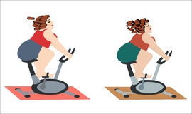 Fat girls are happy to train on the bike. Stock Image