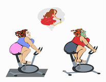 Fat girls are training on the bike Royalty Free Stock Photo