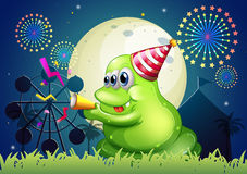A fat green monster celebrating in front of the carnival Stock Images