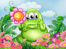 A fat green monster in the garden Royalty Free Stock Photos