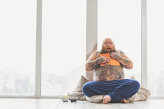 Fat guy is afraid of reading literature Stock Images