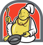 Fat Happy Buddha Chef Cook Cartoon. Illustration of a happy fat Buddha chef cook holding spatula and frying pan sitting down done in cartoon style Royalty Free Stock Photo