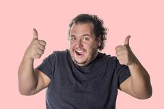Fat happy man show thumb up sign on white background royalty free stock images