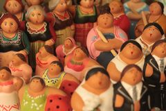 Fat housewives figurines statuettes on sale. Close up of different subjects. Italian souvenir Royalty Free Stock Image
