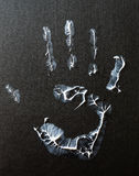 Fat human hand imprint on black background Royalty Free Stock Images