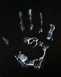 Fat human hand imprint on black, vertical photo Stock Photos
