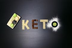 Fat keto peanut butter, cheesecake, matcha balls tea on dark black wooden background. keto protein balls and matcha tea recipes. Ingredients. it works ketogenic stock photos