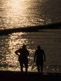 Fat Lady and Man are on The Beach. Before Sunset royalty free stock photography