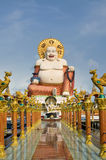 Fat laughing Buddha over blue sky Stock Photography