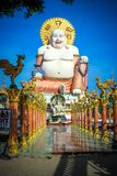 Fat laughing Buddha over blue sky, Koh Samui Royalty Free Stock Photo