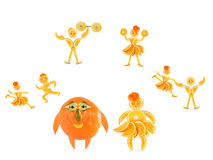 Fat little orange imagines himself a dancer. And an athlete royalty free stock photography
