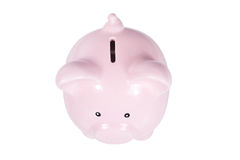 Fat little pink piggy bank isolated on white. Viewed from above showing the coin slot in a success and savings concept Royalty Free Stock Photography