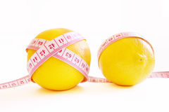 Fat loss. Measure tape and lemon show diet Royalty Free Stock Image