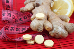 Fat loss supplements. Ginger with lemon for weight loss.  Fat loss supplements Stock Images