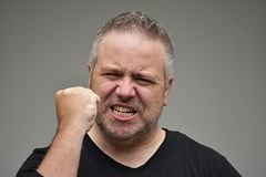 Fat Male And Anger. An overweight and adult male Stock Photos