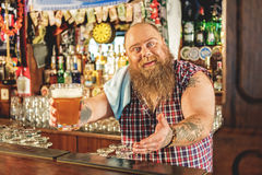 Fat male giving glass of beer Royalty Free Stock Photos