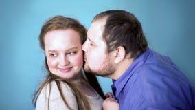Fat male kissing pretty girlfriend in cheek, date flirt, romantic meeting, love. Stock photo royalty free stock image
