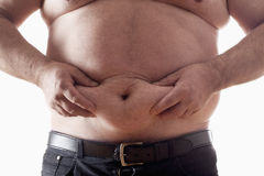 Fat man. Big belly of a fat man isolated on white Stock Photo