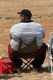 Fat Man. A Fat Man sitting on a chair Royalty Free Stock Image