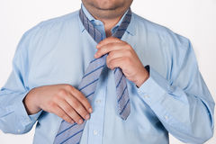 Fat man adjusting tie Stock Image