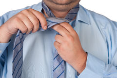Fat man adjusting tie Royalty Free Stock Photography