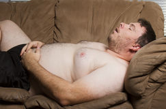 Fat man asleep stock photography