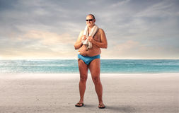 Free Fat Man At The Beach Stock Photography - 63580482
